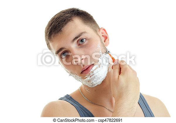 Portrait of a remarkable young man with foam on his face that tilted head and shaved closeup - csp47822691