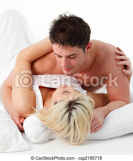 Portrait Of A Romantic Couple On Bed Stock Photo. Portrait of a romantic couple on bed  Portrait of a romantic