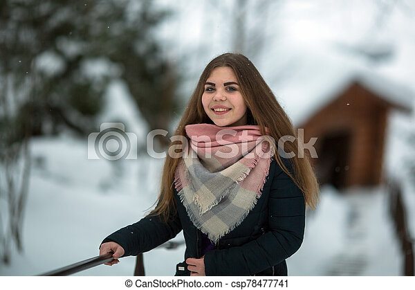 Portrait of a russian woman outdoors in winter. - csp78477741