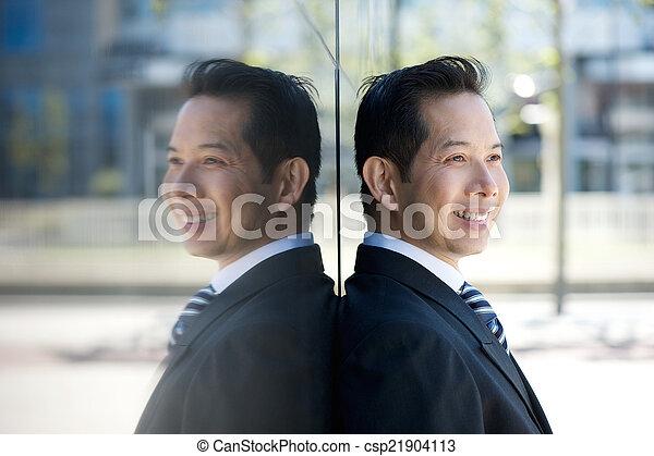 Portrait of a smiling businessman  - csp21904113