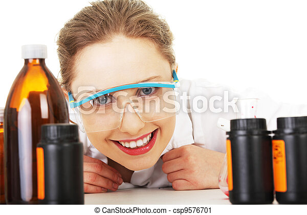 Portrait of a smiling chemist working - csp9576701