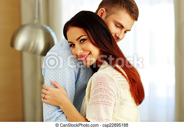 Portrait of a smiling couple hugging - csp22895188