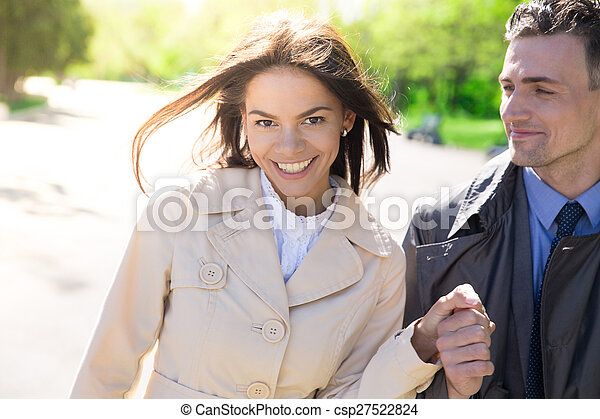 Portrait of a smiling couple outdoors - csp27522824