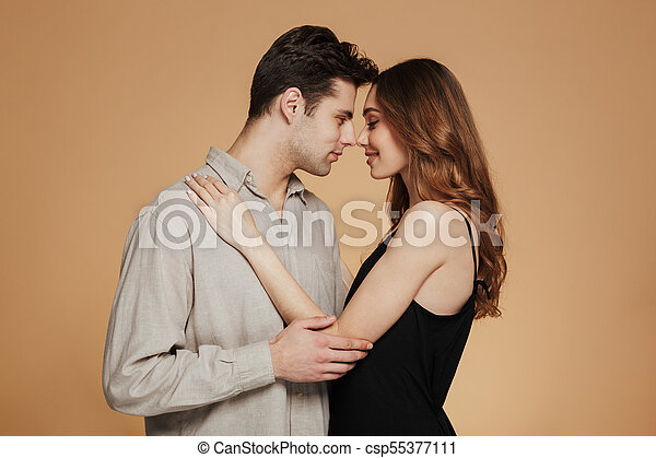 Portrait of a smiling loving couple hugging - csp55377111
