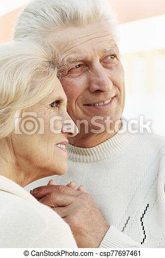 Portrait of a smiling senior couple hugging - csp77697461