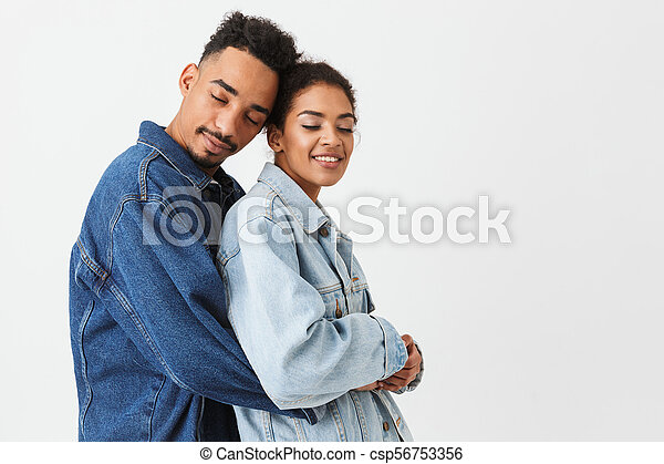 Portrait of a smiling young african couple hugging - csp56753356