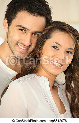 Portrait of a smiling young couple - csp8813078