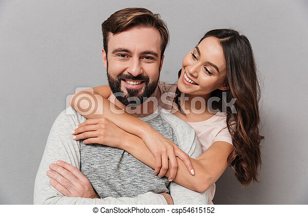 Portrait of a smiling young couple hugging - csp54615152