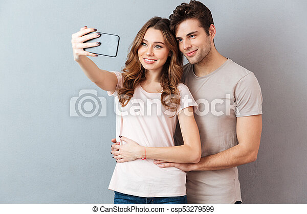 Portrait of a smiling young couple hugging - csp53279599