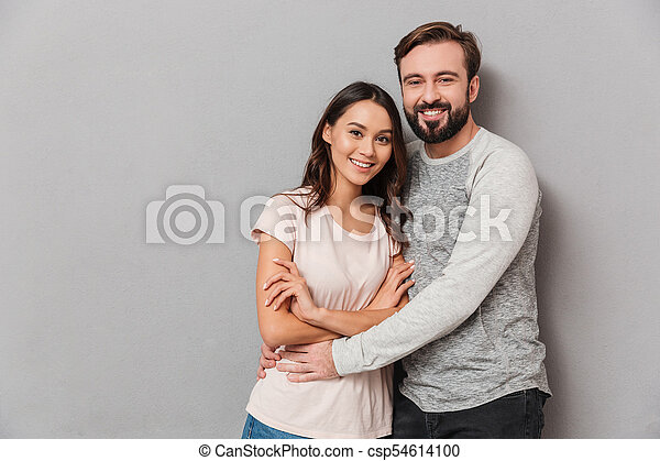 Portrait of a smiling young couple hugging - csp54614100