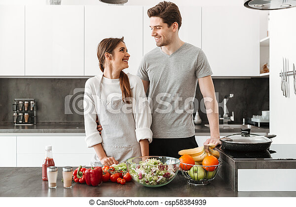 Portrait of a smiling young couple - csp58384939