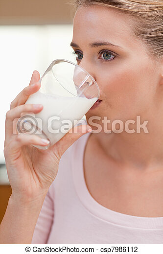 Portrait of a woman drinking a glass of milk - csp7986112