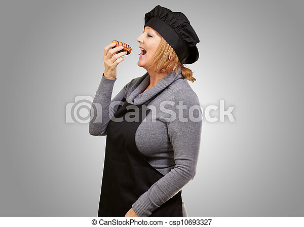 Portrait of a woman having doughnut - csp10693327