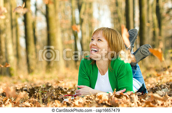 Portrait of a woman in autumn park - csp16657479