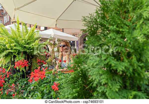 portrait of a woman in cafe - csp74693101