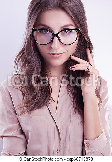 Portrait of a woman in glasses on white background - csp66713878