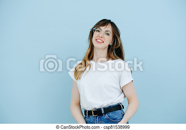 Portrait of a woman in large glasses with diopters - csp81538999