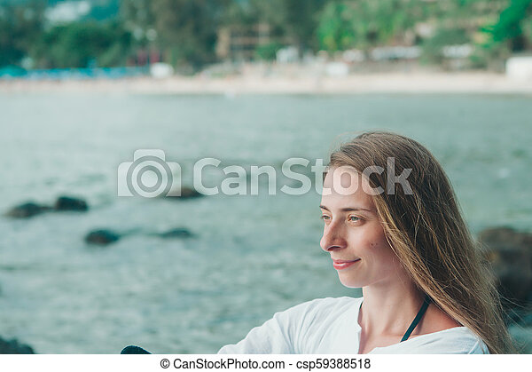 Portrait of a woman in white clothes on the beach background - csp59388518