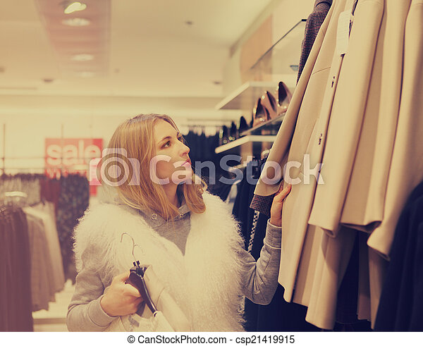 Portrait of a woman shopping in retail store - csp21419915