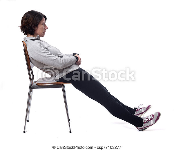 portrait of a woman sitting on a chair in white background, relax - csp77103277