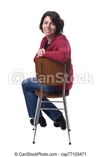 portrait of a woman sitting on a chair in white background - csp77103471