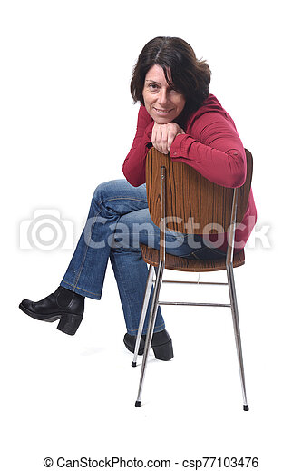 portrait of a woman sitting on a chair in white background - csp77103476