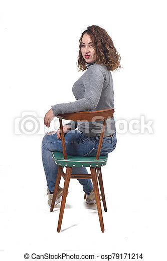 portrait of a woman sitting on a chair in white background - csp79171214