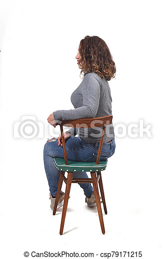 portrait of a woman sitting on a chair in white background, profile - csp79171215