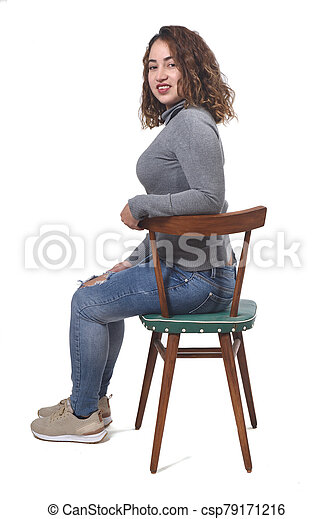 portrait of a woman sitting on a chair in white background, - csp79171216