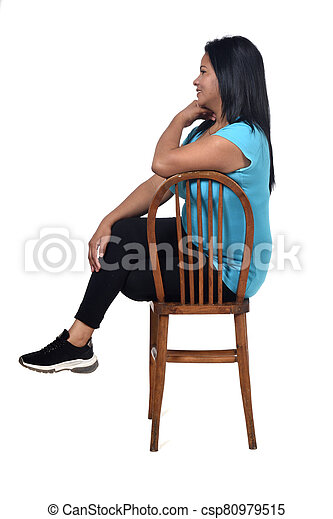 portrait of a woman sitting on a chair in white background, - csp80979515