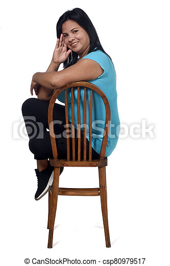 portrait of a woman sitting on a chair in white background, - csp80979517