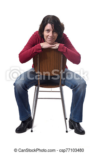 portrait of a woman sitting on a chair in white background - csp77103480