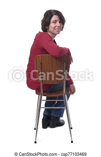 portrait of a woman sitting on a chair in white background - csp77103469