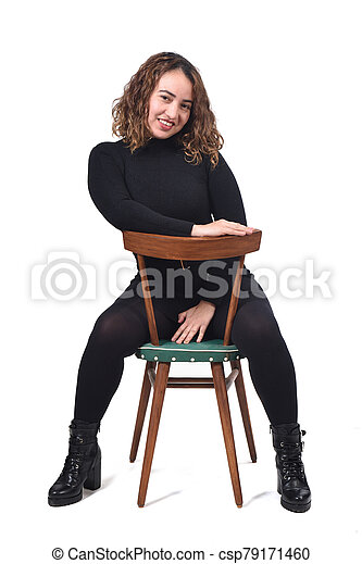 portrait of a woman sitting on a chair in white background, - csp79171460