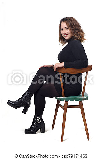 portrait of a woman sitting on a chair in white background - csp79171463