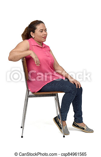 portrait of a woman sitting on a chair with the body in profile and look side on white background, - csp84961565