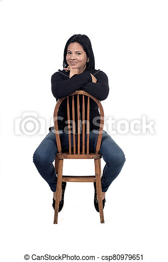 portrait of a woman sitting on a chair in white background - csp80979651