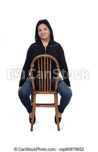 portrait of a woman sitting on a chair in white background - csp80979652