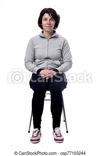 portrait of a woman sitting on a chair in white background - csp77103244