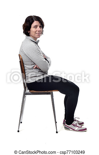 portrait of a woman sitting on a chair in white background - csp77103249