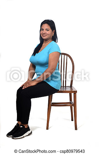 portrait of a woman sitting  on a chair in white background - csp80979543
