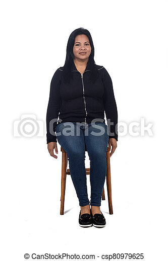 portrait of a woman sitting on a chair in white background - csp80979625
