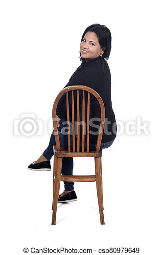 portrait of a woman sitting on a chair in white background - csp80979649