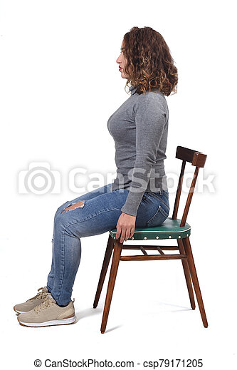 portrait of a woman sitting on a chair in white background, profile - csp79171205
