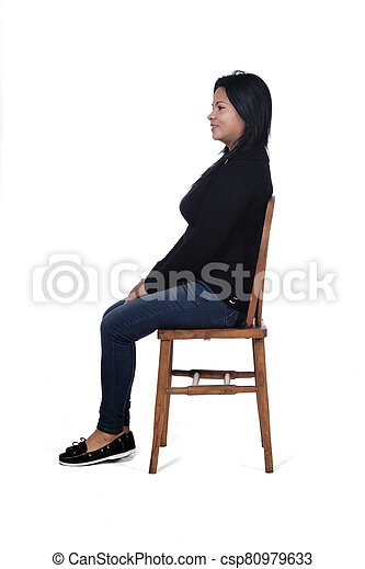 portrait of a woman sitting on a chair in white background - csp80979633
