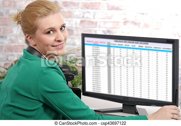 portrait of a woman working with a computer - csp43697122