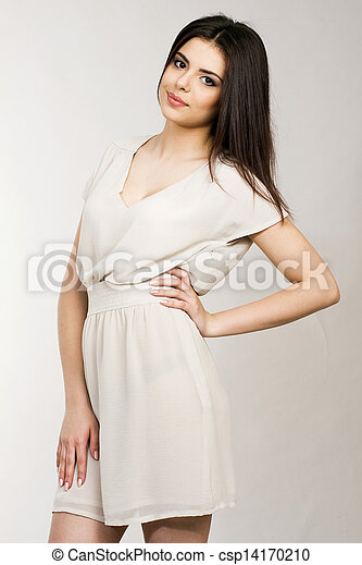 Portrait of a young attractive woman in dress - csp14170210