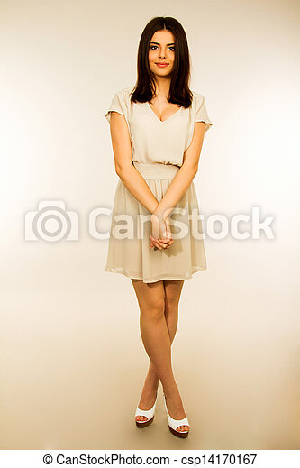 Portrait of a young attractive woman in dress - csp14170167