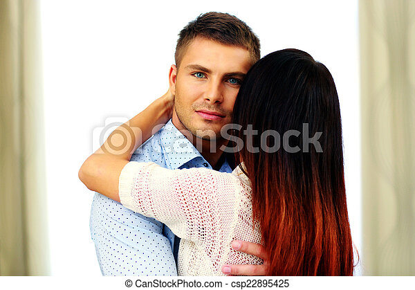Portrait of a young beautiful couple hugging - csp22895425
