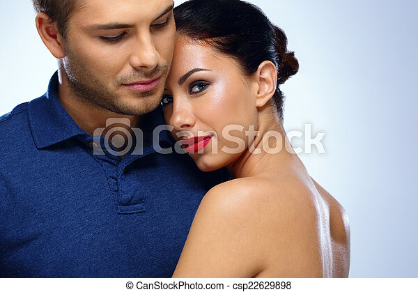 Portrait of a young beautiful couple hugging - csp22629898